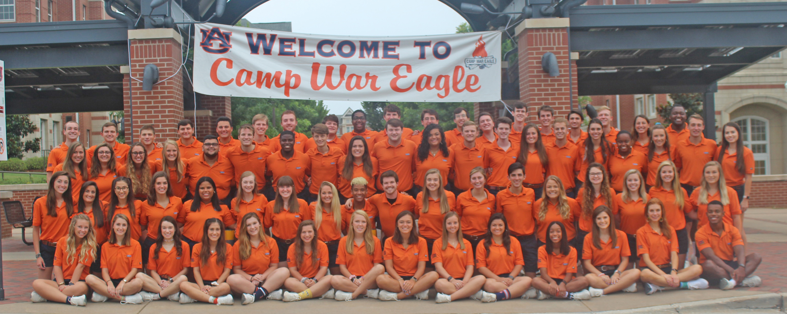 2019 Camp War Eagle Counselors in front of Welcome to Camp War Eagle sign