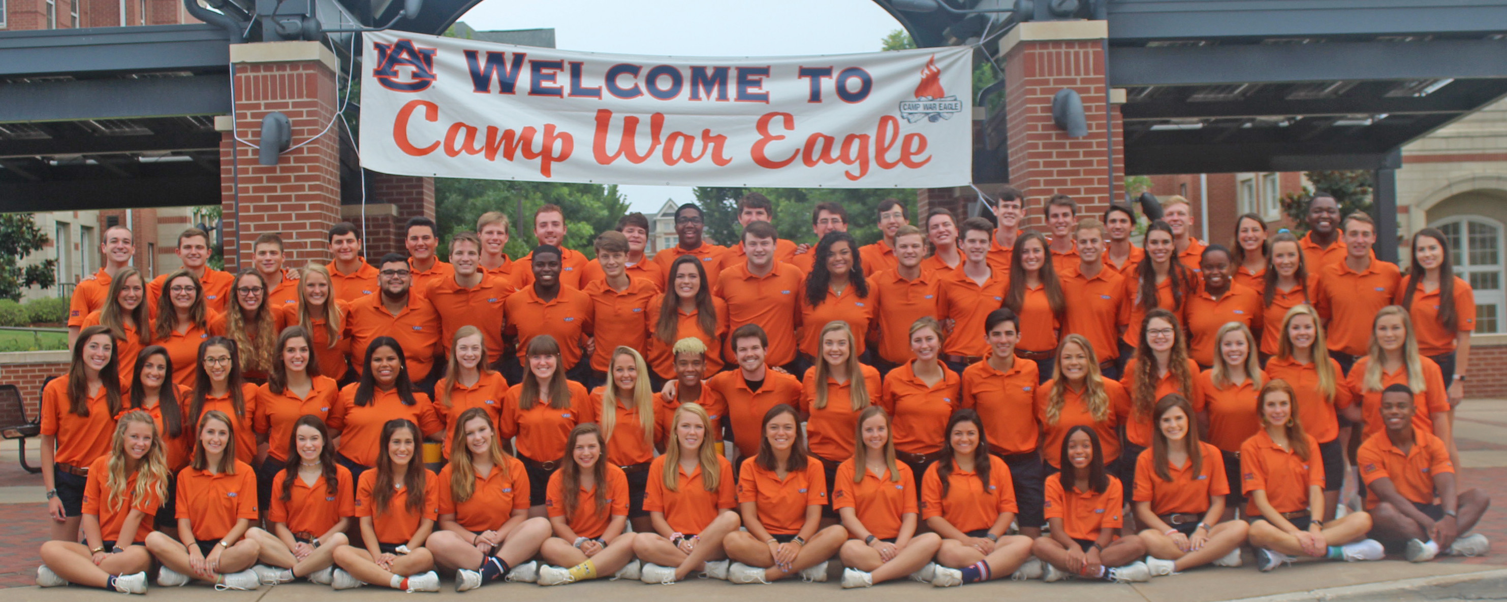 Large group of Camp War Eagle Counselors in front of Welcome to Camp War Eagle sign