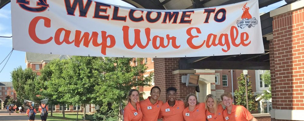 6 Counselors in front of Welcome to Camp War Eagle Banner