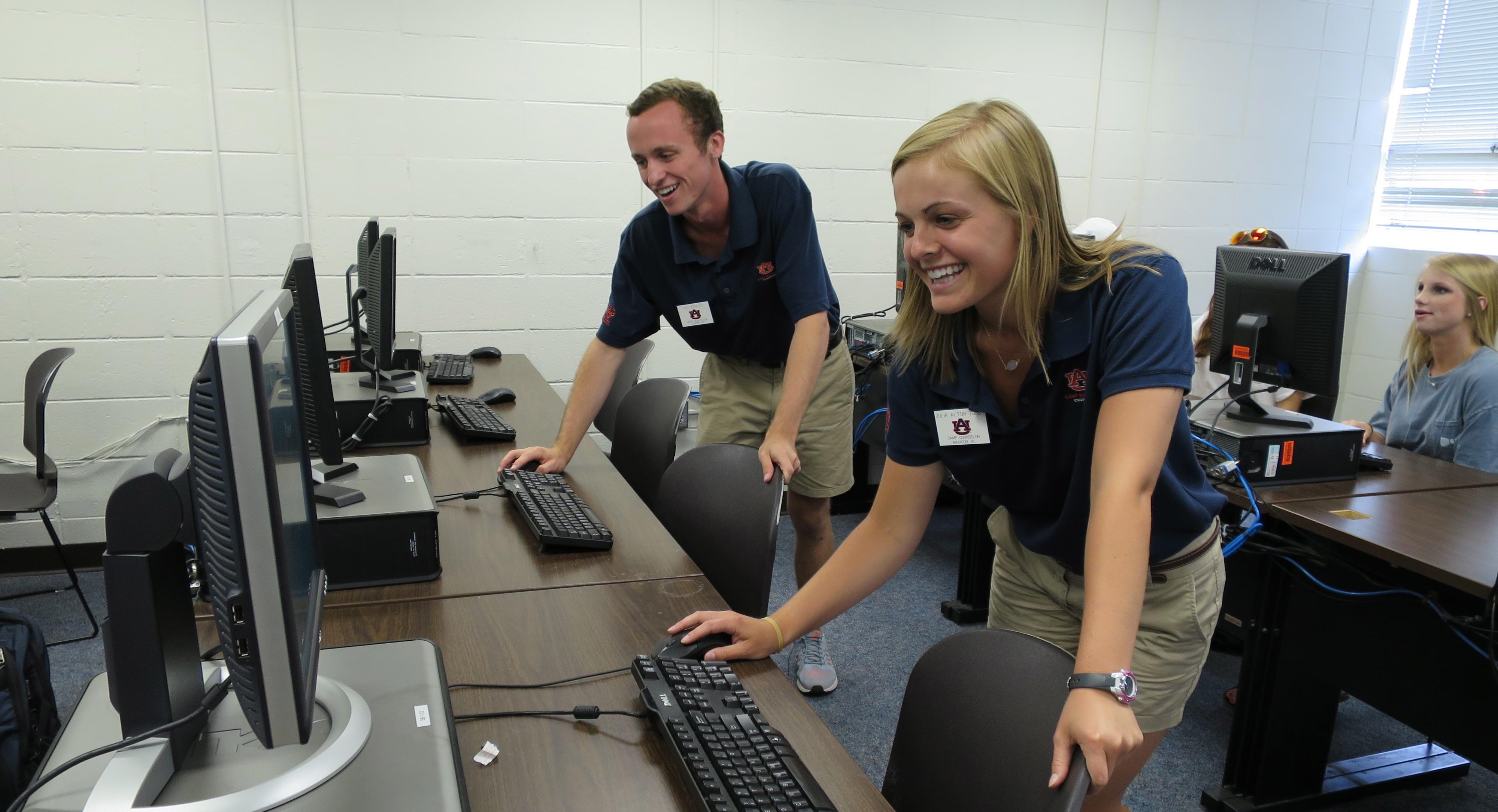 Camp War Eagle staff preparing computers for student registration