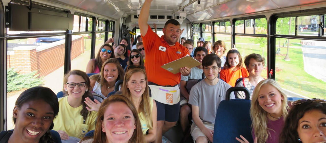 Camp War Eagle staff member in bus full of students