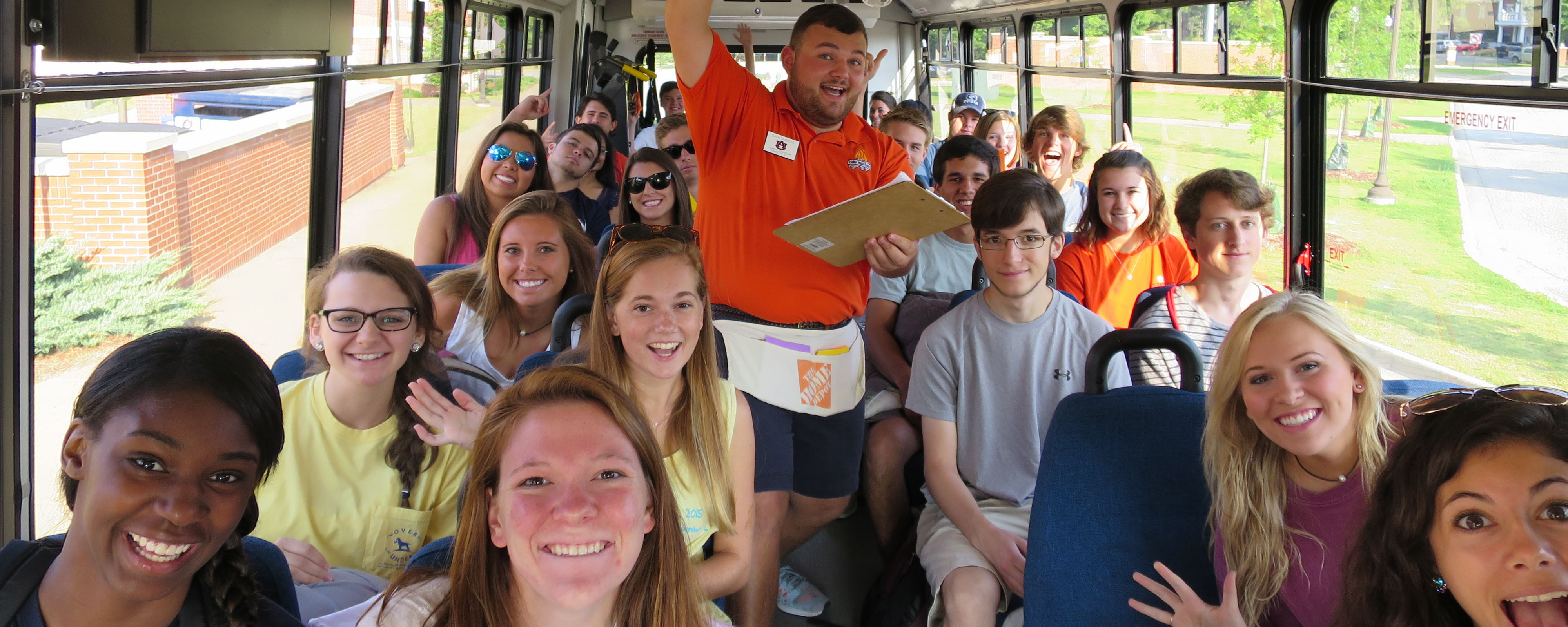 Counselor riding bus with students to check in